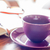 Purple coffee cup on wooden table stock photo © punsayaporn