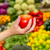 woman holding red tomato in supermarket stock photo © pxhidalgo