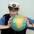 man in a sea cap compresses globe in hands stock photo © pzaxe
