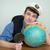 man in a sea uniform cap with globe and magnifier stock photo © pzaxe