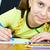 Girl holding a blue pencil stock photo © pzaxe