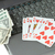laptop playing cards and dollars stock photo © pzaxe