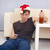 people in christmas hat sits on a floor with beer stock photo © pzaxe