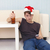 young man in christmas hat sits on a floor with beer stock photo © pzaxe