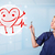 attractive doctor with happy red smiling heart stock photo © ra2studio