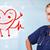 atrakcyjny · lekarza · szczęśliwy · czerwony · uśmiechnięty · serca - zdjęcia stock © ra2studio