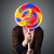 young woman holding a lollipop stock photo © ra2studio
