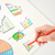business person drawing colorful graphs and icons on paper stock photo © ra2studio