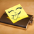 post it note with smiley face sticked on hip flask stock photo © ra2studio