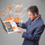 biznesmen · notebooka · wykresy · statystyka · garnitur - zdjęcia stock © ra2studio