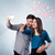 couple in love taking selfie with red heart stock photo © ra2studio