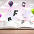 Open book with flying 3d letters on concrete background stock photo © ra2studio