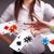 młoda · kobieta · gry · poker · karty · chipy · dość - zdjęcia stock © ra2studio