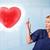 jóvenes · enfermera · curación · rojo · corazón · bastante - foto stock © ra2studio