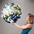 pretty girl holding 3d planet earth stock photo © ra2studio