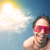 young person looking with sunglasses at clouds and sun stock photo © ra2studio