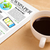tablet pc shows news on screen with a cup of coffee on a desk stock photo © ra2studio
