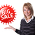 young happy businesswoman presenting big sale sign on her hand stock photo © ra2studio