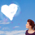 cute girl looking at white heart cloud on blue sky stock photo © ra2studio