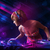 young dj playing on turntables with color light effects stock photo © ra2studio