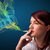 Pretty lady smoking cigarette with colorful smoke stock photo © ra2studio