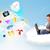 fiatal · üzletember · ül · felhő · laptop · csinos - stock fotó © ra2studio