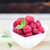 fresh raspberry fruits in white bowl on wooden table stock photo © rafalstachura