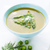 asparagus soup in a bowl topped with fresh cream dill and chive stock photo © rafalstachura