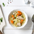 Top view of chicken soup with pasta, carrot and parsley on white stock photo © rafalstachura