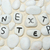 next step words on pebbles stock photo © raywoo