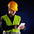 young engineering with orange helmet working on a tablet pc stock photo © razvanphotos