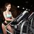 jovem · bela · mulher · treinamento · equitação · bicicleta · ginásio - foto stock © restyler