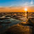 faible · marée · coucher · du · soleil · homme · permanent · plage - photo stock © rghenry