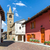 colorful houses and old church in small italian town stock photo © rglinsky77