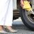woman changing car tyre stock photo © roboriginal