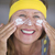 skin care lotion smiling mature woman portrait stock photo © roboriginal