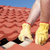 Worker repairing roof tiles on house stock photo © roboriginal
