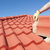 Construction worker tile roofing repair house stock photo © roboriginal