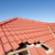 damaged red tile roof construction house stock photo © roboriginal