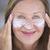 happy mature woman face creme portrait stock photo © roboriginal