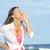 altos · mujer · positivo · gesto · océano · hermosa - foto stock © roboriginal