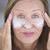friendly mature woman face creme portrait stock photo © roboriginal