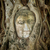 ancient buddha entwined within tree roots in thailand stock photo © rognar