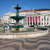 fountain and theater on rossio square in lisbon stock photo © rognar