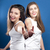 two young happy women showing thumbs up over blue screen background stock photo © rosipro