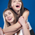 dois · jovem · feliz · mulheres · azul · tela - foto stock © rosipro