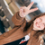 happy teen girl showing victory or peace sign stock photo © rosipro