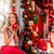 young woman decorating christmas tree stock photo © rosshelen