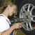 pneumatici · garage · femminile · auto · meccanico · blu - foto d'archivio © runzelkorn