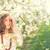 nina · flor · de · cerezo · vestido · blanco · pie · sonriendo - foto stock © runzelkorn